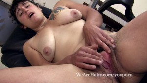 Hairy Valerie plays with her hairy pussy at her desk