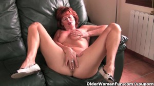 Redheaded mature mom plays with her nipples and pussy