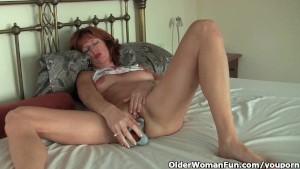 Mature redheaded mom masturbates with dildo