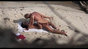 Young couple caught on the beach