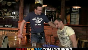 He swallows his first cock right in the bar