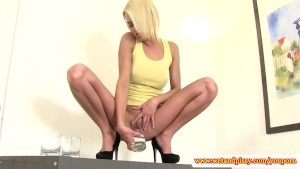 Solo blonde pissing while masturbating