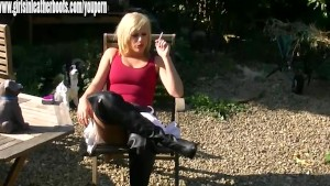 Sexy blonde gives you close ups of her pussy while smoking in leather boots