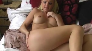 Sexy blonde babe warms up her tight shaved pussy for her boss