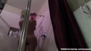 Nikita takes a hot shower