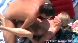 Blonde milf blows her hubby and gets fucked at the beach