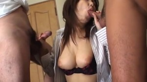 Cute oriental babe sucking off two cocks at once