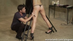 Stuning brunette gets tied up and spanked