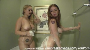 two hot young bbws taking a naked bath together