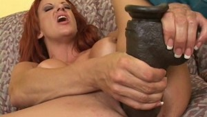 Busty redhead with brutal dildos