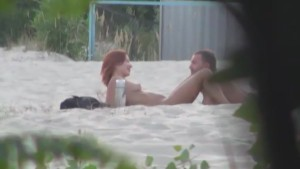 Voyeur spies on pussy licking at a beach