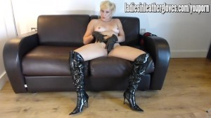 Sexy blonde teases and rubs pussy in leather gloves and thigh high boots