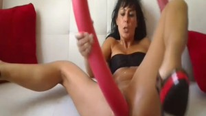 Hot brunette fucking a gigantic toy