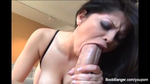 Evie Delatosso puts her big tits and lips all over a cock