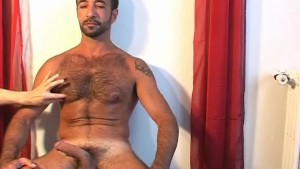 My sexy gym trainer gets wanked his big cock by a guy in a porn movie!