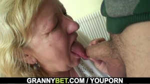 Busty 70 years old granny tastes his cock