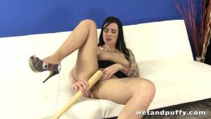 Hottie Kirsten Wild plays with a baseball bat