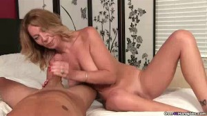 Naughty Milf Finds Him Laying Naked In Her Bed
