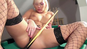 Blonde masturbates in fishnet stockings and heels