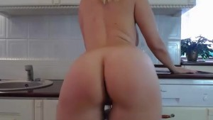 My stunning step mother playing around in the kitchen