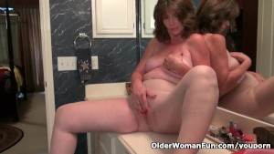 American granny Ava is having bathroom fun