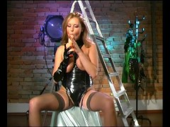 Horny cougar in latex plays with dildo - Pleasure Photorama
