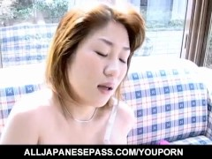 Yui Natsume horny fucks her vagina with vibrator in nature
