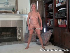 Granny Claire plays with her unshaven pussy