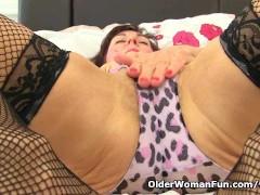 British milf Georgie fucks her hairy pussy with a dildo