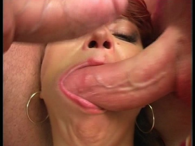 Two cocks in mouth