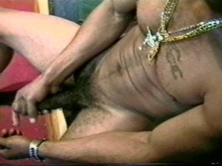 Blinged out gangster yanks his dick...
