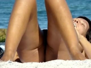 Spreading legs at the beach...