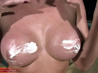 Mature tranny with big lips strokes shaved cock by the pool