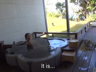 Mature tae bathes in outdoor onsen...